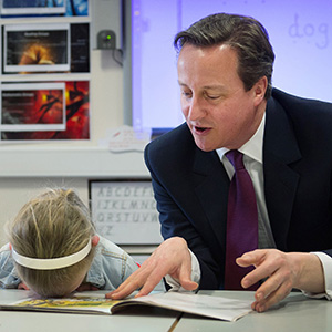 Prime Minister David Cameron helps with a reading lesson at the Sacred Heart Roman Catholic Primary School in Westhoughton near Bolton where he met pupils, Lucy Howarth , six, and Will Spibey, five, while on the General Election campaign trail. (Stefan Rousseau/PA)
